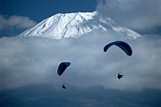 Snow Scenes Metal Prints - Paragliders Float In The Clouds That Metal Print by Karen Kasmauski