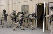 Hostage Posters - Pararescuemen Enter A Building Poster by Stocktrek Images