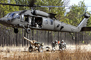 Uh-60 Black Hawk Prints - Paratroopers Connect A Howitzer Print by Stocktrek Images