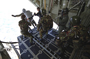 Paratrooper Photo Prints - Paratroopers Jump From A C-130 Hercules Print by Andrew Chittock