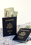 Identification Posters - Passports with map and money Poster by Blink Images