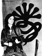 Beret Prints - Patricia Hearst With Weapon Posing Print by Everett