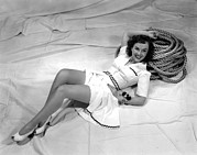 Short Skirt Posters - Paulette Goddard, Reclining Poster by Everett