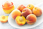 Sliced Framed Prints - Peaches on plate Framed Print by Elena Elisseeva