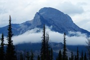 Mountain Photos - Peak above the Clouds by Larry Ricker