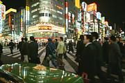 Pedestrians Cross A Crowded Tokyo Print by Justin Guariglia