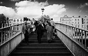 Halfpenny Prints - Pedestrians Crossing The Halfpenny Hapenny Bridge Over The River Liffey In The Centre Dublin Ireland Print by Joe Fox