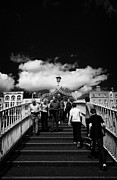Halfpenny Prints - Pedestrians Crossing The Halfpenny Hapenny Bridge Over The River Liffey In The Centre Of Dublin City Print by Joe Fox