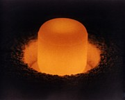 Isotopes Posters - Pellet Of Plutonium-238 Glowing Poster by Everett