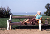 Elderly Woman Posters - Pensioner Relaxing On A Bench Poster by Victor De Schwanberg
