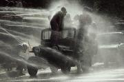 People Are Sprayed At The Water Print by James L. Stanfield