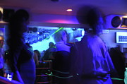 Enjoyment Photos - People dancing and light effects in discotheque by Sami Sarkis