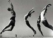 Four People Posters - People Exercising On Beach (b&w) Poster by Hulton Archive