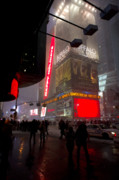 Gathering Photos - People in Times Square during New York Blizzard  by Rosemary Hawkins