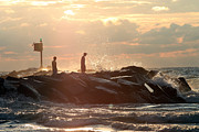 Slam Photo Prints - People walking on New Buffalo Michigan breakwater Print by Purcell Pictures