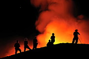 Silhouetted Posters - People watching lava flowing to the sea from Kilauea Volcano Poster by Sami Sarkis