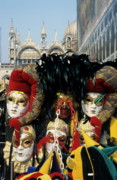 Basilica Di San Marco Prints - Person surrounded by elaborate masks for sale on St Marks Basilica Print by Sami Sarkis