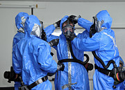 Personnel Dressed In Hazmat Suits Print by Stocktrek Images