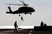 Uss Ronald Reagan Prints - Personnel Fast-rope Out Of An Sh-60f Print by Stocktrek Images