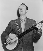 Folk Singer Posters - Pete Seeger B. 1919 Singing Playing Poster by Everett