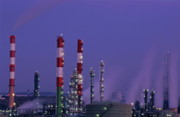 Sami Sarkis Metal Prints - Petroleum refinery chimneys at dusk Metal Print by Sami Sarkis