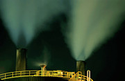 Storage Prints - Petroleum refinery chimneys at night Print by Sami Sarkis