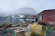 Boathouses Photos - Petty Harbour In Fog, Newfoundland by David Nunuk