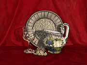 Crystal Pitcher Framed Prints - Pewter dish with red cloth. Framed Print by Raffaella Lunelli