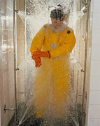 Shower Prints - Pharmaceutical Worker In Isolation Suit Shower Print by Geoff Tompkinson