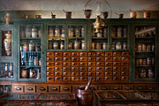 Cabinet Posters - Pharmacy - Right behind the counter Poster by Mike Savad