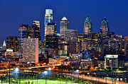 Downtown Posters - Philadelpia Skyline at Night Poster by Jon Holiday
