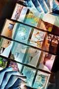 Creativity Art - Photographer looks at a sheet of slides by Tal Bedrak