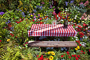 Champagne Glasses Photos - Picnic table among the flowers by Garry Gay