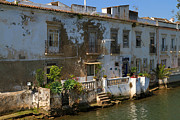 Peeling Stucco Posters - Picturesque waterfront house on the River Gilao in Tavira Poster by Louise Heusinkveld