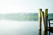 Wooden Post Framed Prints - Pier At River Havel Framed Print by Andreas Levers