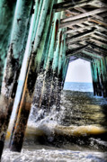 Beach Scenes Photo Prints - Pier Splash Print by Emily Stauring