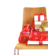 Pile Of Gifts On Wooden Chair Against White Print by Sandra Cunningham