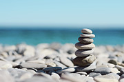 On Top Of Prints - Pile Of Stones On Beach Print by Dhmig Photography