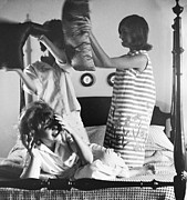 Nineteen Sixties Prints - Pillow Fight Print by Vivienne Della Grotta and Photo Researchers