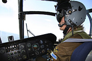 Pilot In The Cockpit Of A Ch-46 Sea Print by Daniel Karlsson