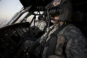 Cockpit Photo Prints - Pilot In The Cockpit Of A Uh-60l Print by Terry Moore