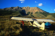 Close To People Posters - Pilot Of Ultralight Plane Taking Camping Excursion, Near Borah Peak, Idaho, United States Of America, North America Poster by Holger Leue