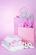 Baby Clothes Posters - Pink baby shower presents Poster by Elena Elisseeva