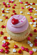 Frosting Posters - Pink cupcake with candy hearts Poster by Garry Gay