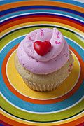 Frosting Posters - Pink cupcake with red heart Poster by Garry Gay