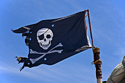Waving Photos - Pirate flag skull and cross bones by Garry Gay