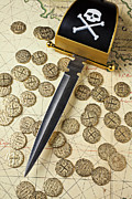 Pirates Photos - Pirate sword and gold coins on old may by Garry Gay