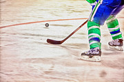 Hockey Player Photos - Playing the Puck by Karol  Livote