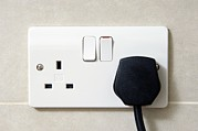 Electrical Plug Prints - Plug In An Electric Wall Socket Print by Johnny Greig