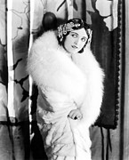 White Fur Prints - Pola Negri Wearing A White Knee-length Print by Everett